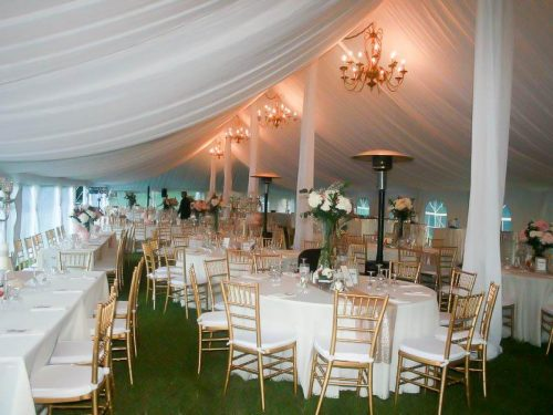 White and Gold Chiavari Chair Rental Drapes Chandeliers Heaters Grass